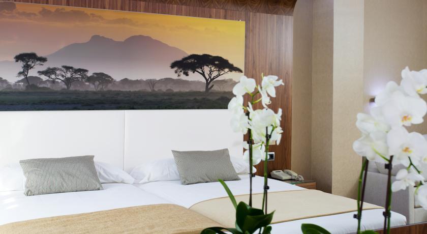 16 topp hotell i madrid overnatting i madrid i spania for Jardin de recoletos